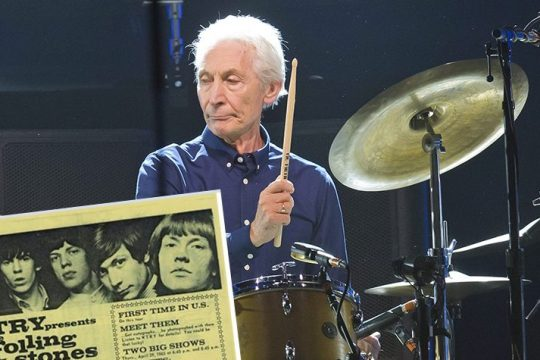 Charlie Watts, of the Rolling Stones, performs during a concert of the group's No Filter Europe Tour at U Arena in Nanterre, outside Paris, France, on Oct. 22, 2017. (Associated Press photo) Inset:A poster for the Rolling Stones' 1965 performance in Albany. Watts is pictured second from right. (Courtesy Gary Greenberg)