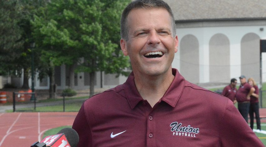 Union College head football coach Jeff Behrman speaks with reporters during the team's media day on Tuesday, Aug. 24 at Frank Bailey Field in Schenectady.