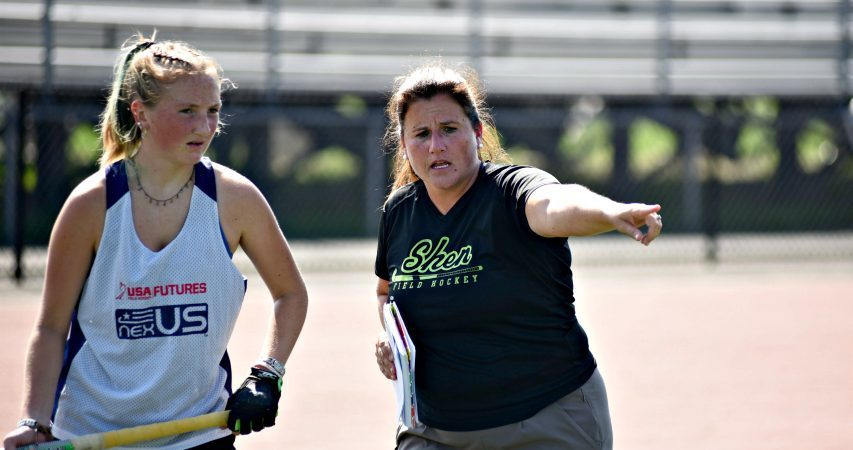 First-year Shenendehowa varsity field hockey coach Shawn Eggleston, right, gives instructions on a drill during Tuesday's practice at the Shenendehowa turf field on the Clifton Park campus.