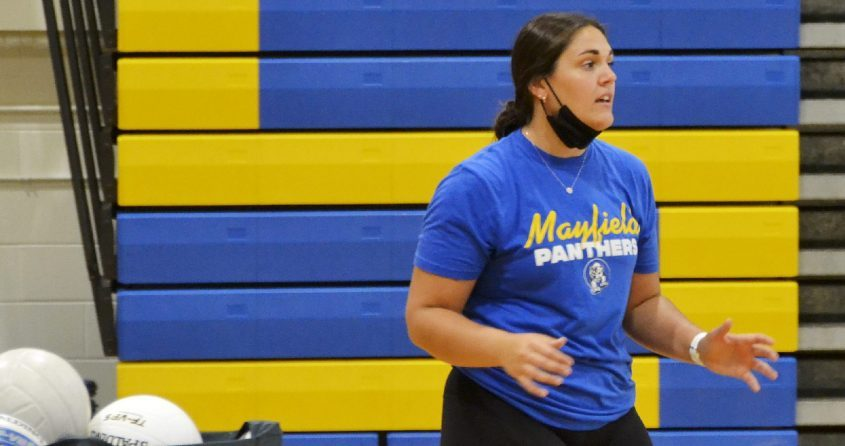 First-year Mayfield volleyball coach Brynn Hlozansky directs her team during practice Tuesday at Mayfield High School.