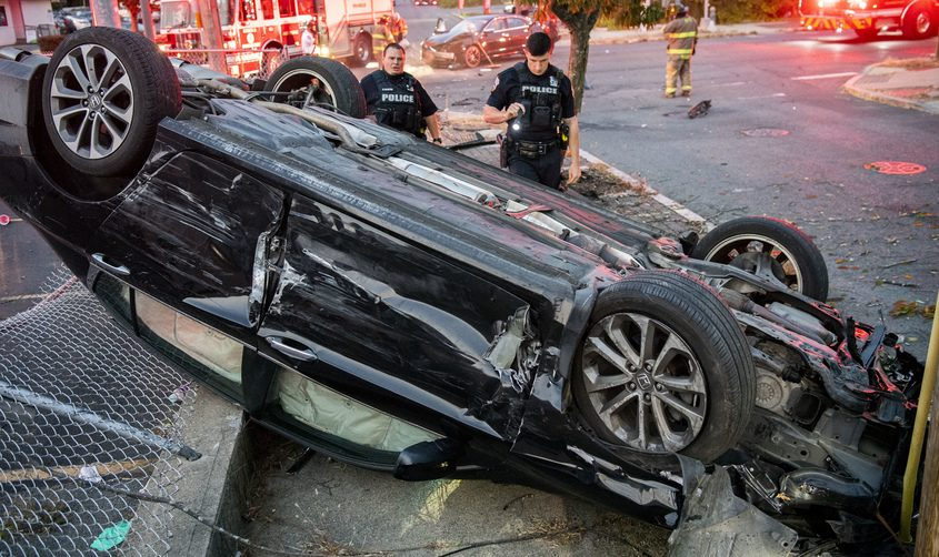 Schenectady police officers check the damage to an overturned Honda Accord that ran the traffic light at State Street and Fehr Avenue, and into the path of a Nissan Altima just before 7 p.m., September 22, 2020. The accident occurred a half-mile from Fehr and Golf Road.