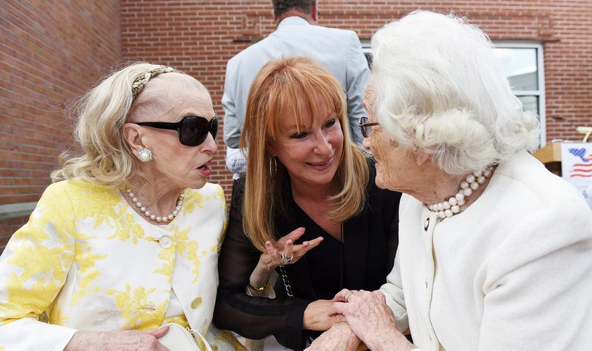 Marcia White, center,and her friendsMarylou Whitney and Jane Wait chat duringa ceremony at National Museum of Racing and Hall of Fame in Saratoga Springs in 2018.