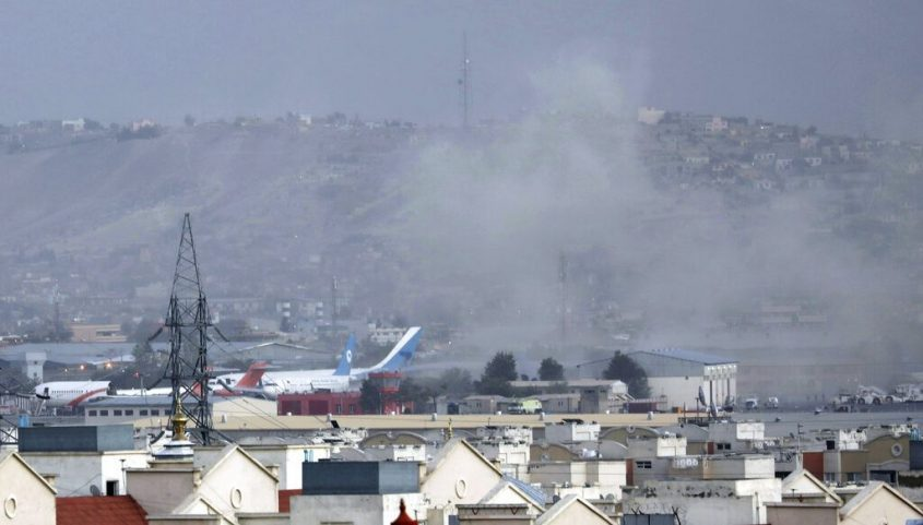 Smoke rises from a deadly explosion outside the airport in Kabul, Afghanistan, Thursday.