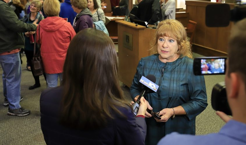 Mary Hartshorne speaks to a television news crew in 2019 about the plight of former employees of the old St. Clare's Hospital who had lost their pensions.