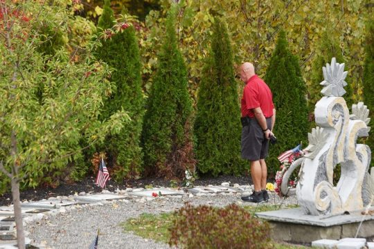 A man visits the Schoharie Limousine Crash Memorial at intersection of routes 30 and 30A in Schoharie on Sept. 29, 2020.