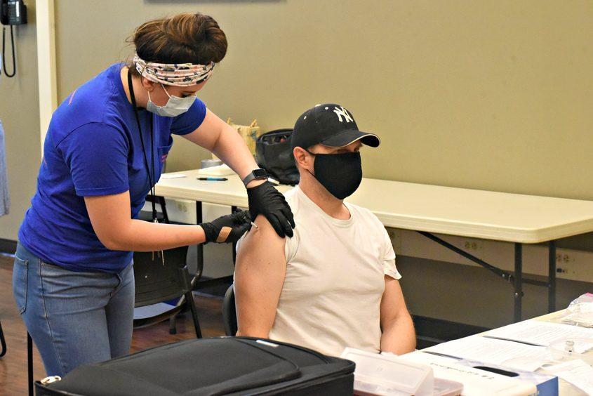 Philip Alexander of Ballston Spa gets his Pfizer vaccine from Schenectady County Public Health Services nurse Meghan Martterer at the Alplaus Fire House on Aug. 19, 2021.