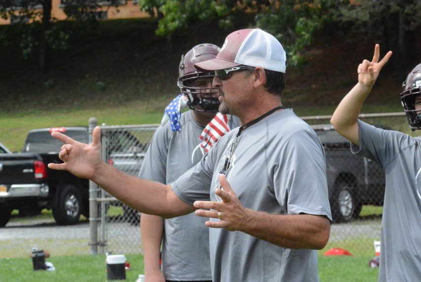 Gloversville football coach James Robare gives instructions during practice on Monday, Aug. 23 at Park Terrace Elementary School.