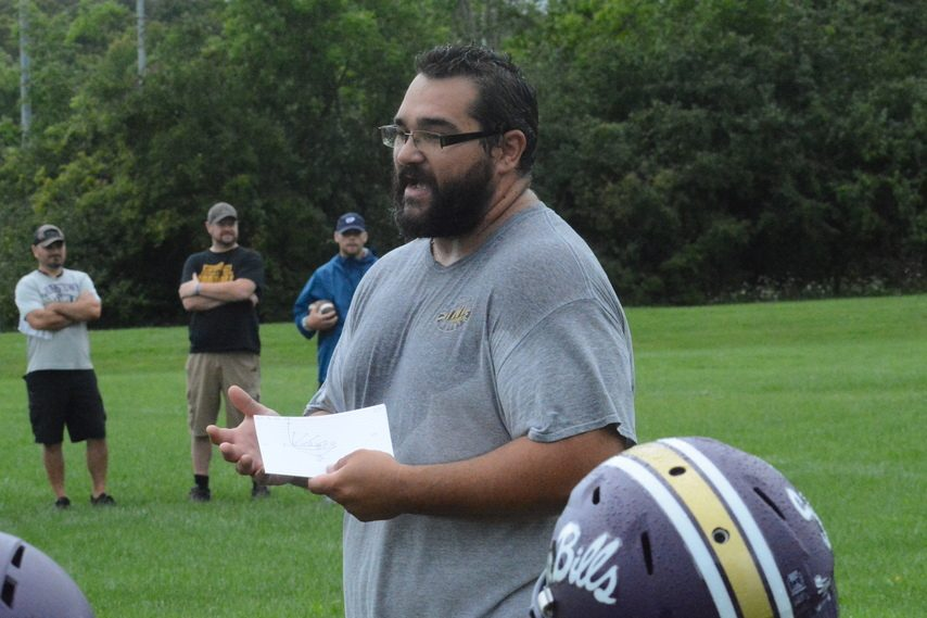 Johnstown football coach Paul Furman gives instructions during practice on Monday, Aug. 23 at Johnstown Junior/Senior High School.