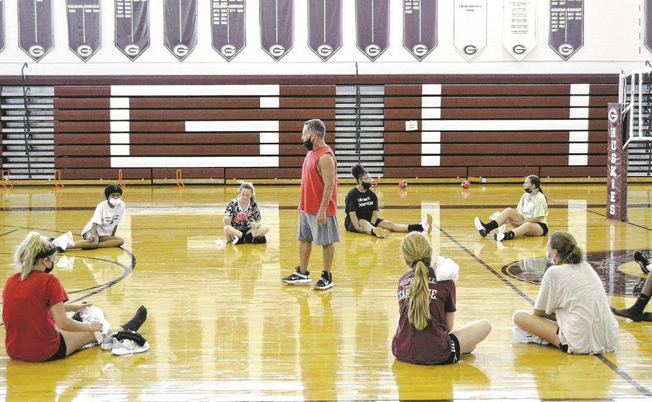 Gloversville volleyball coach Duane Hicks talks with his team during practice Wednesday at Gloversville High School.
