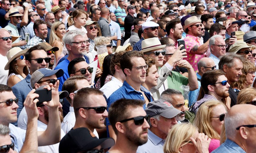 Patrons watch the races on the Apron on Travers Day 2019 at Saratoga Race Course in Saratoga Springs.