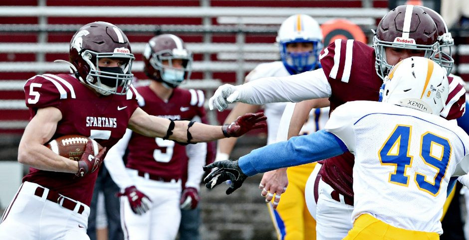Burnt Hills-Ballston Lake's Michael Puglisi with the ball against Queensbury during their high school football game at Burnt Hills-Ballston Lake High School on Friday, April 2.