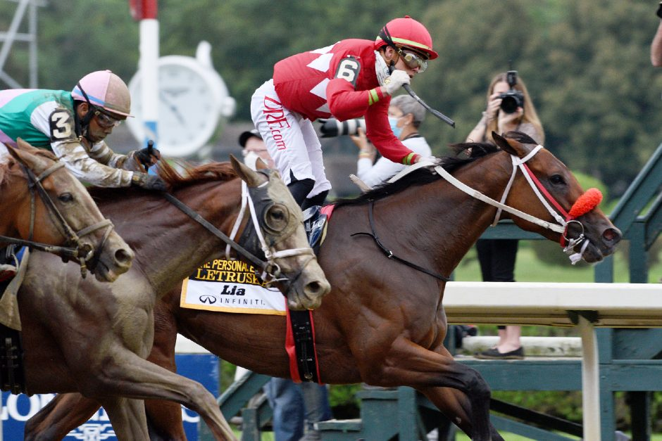 Letruska, right, ridden by Irad Ortiz Jr., wins the Grade I Personal Ensign on Saturday at Saratoga Race Course.