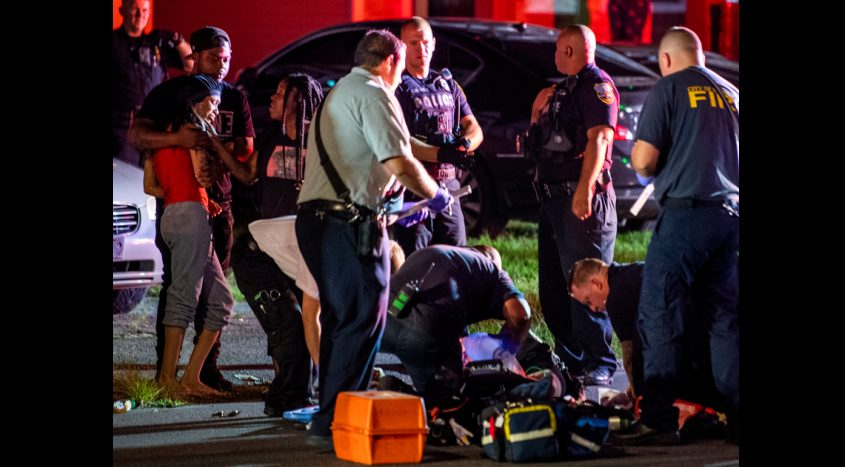 Schenectady firefighters tend to a shooting victim on Albany Street early Sunday.