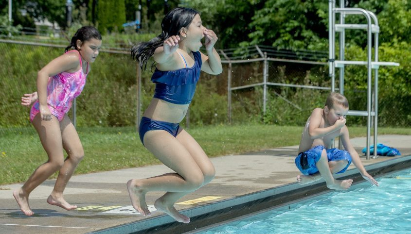 Cousins (front-back) Audrina Morrone 9 , and Luna Bonilla 8, and Luke Grasek, 6 all of Amsterdam, jump into the pool at the City of Amsterdam's pool, during free-admission day (and Friday) sponsored by Bethany Schumann McGhee Attorney at Law, in Amsterdam on Thursday, August 12, 2021.