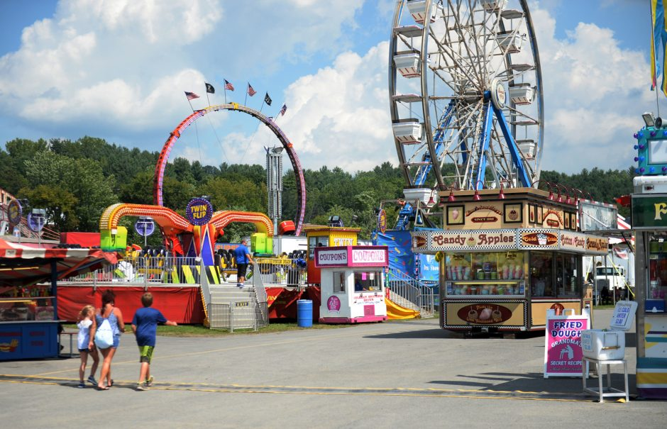 This 2018 photo shows people arrivingahead of opening day at the Fonda Fair.