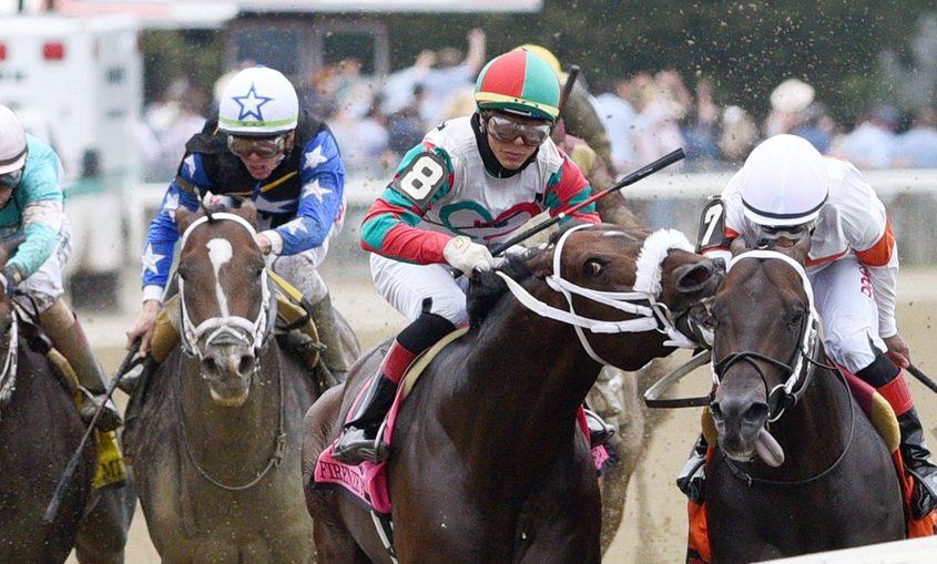 Yaupon (right), ridden by Ricardo Santana, Jr. as Firenze Fire ridden by Jose Ortiz tries to bite him Saturday