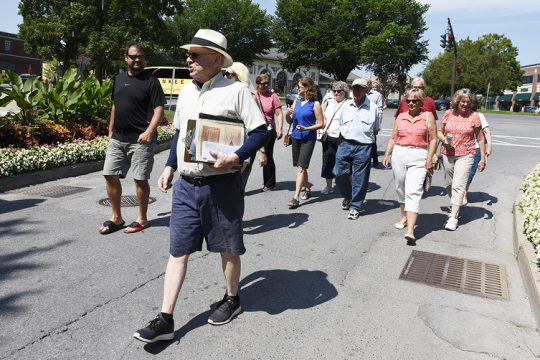 A guidebeginsa walking tour into Congress Park in 2017.