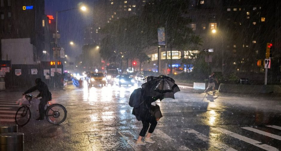 Pedestrians take cover near Columbus Circle in New York Wednesday