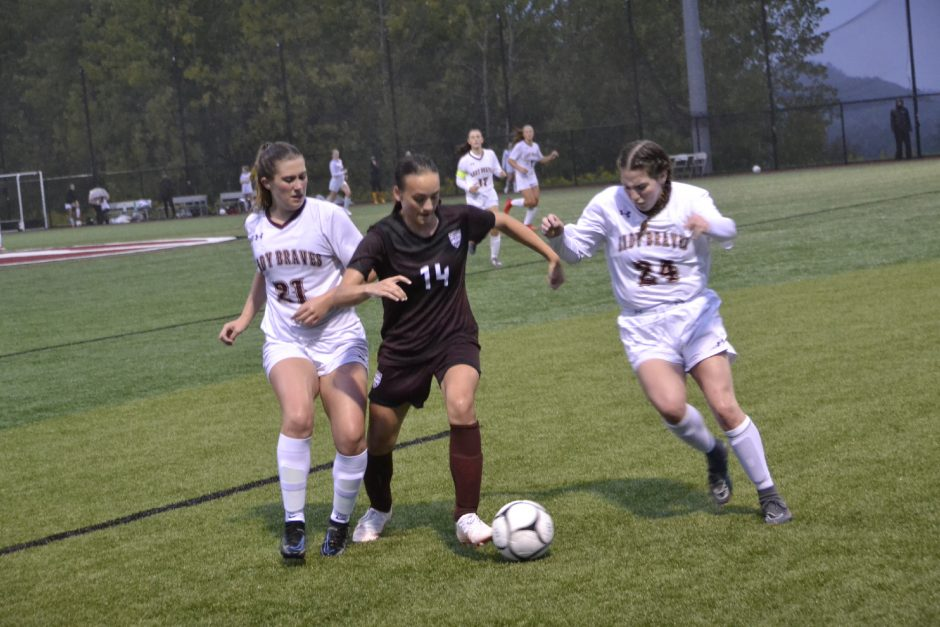 Gloversville's Hannah Wilkinson (14) battles with Fonda-Fultonville's Kaitlyn Birkholz (21) and Janiece Roman (24) for possession of the ball during Wednesday's non-league girls' soccer contest at Gloversville High School. (Paul Wager/The Daily Gazette)