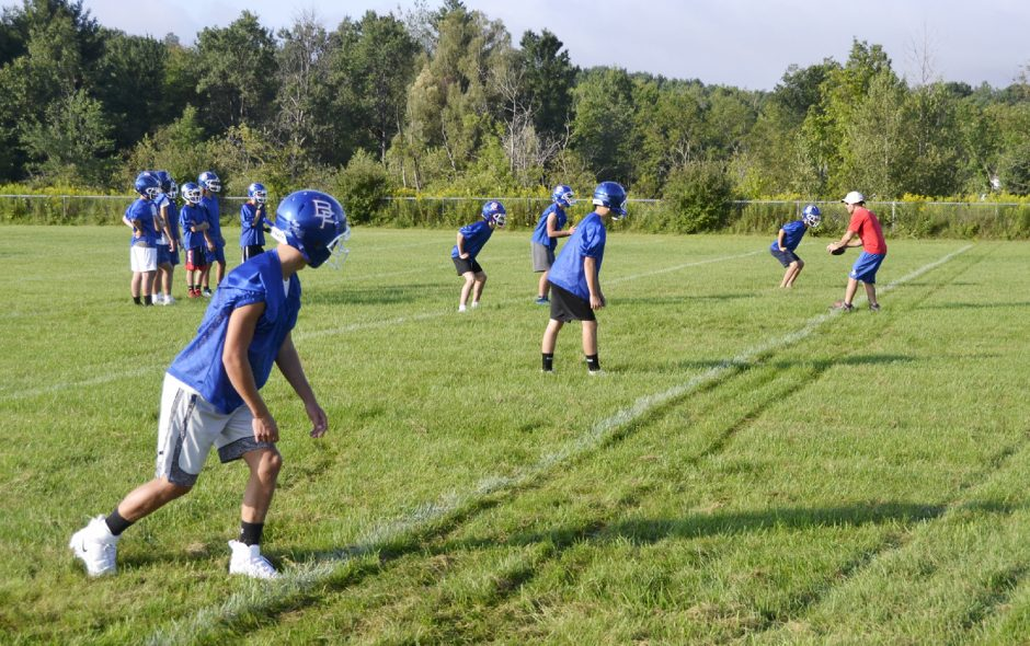 Broadalbin-Perth assistant coach Vincent Calderone, right, leads players through a drill during practice Tuesday at Broadalbin-Perth High School.