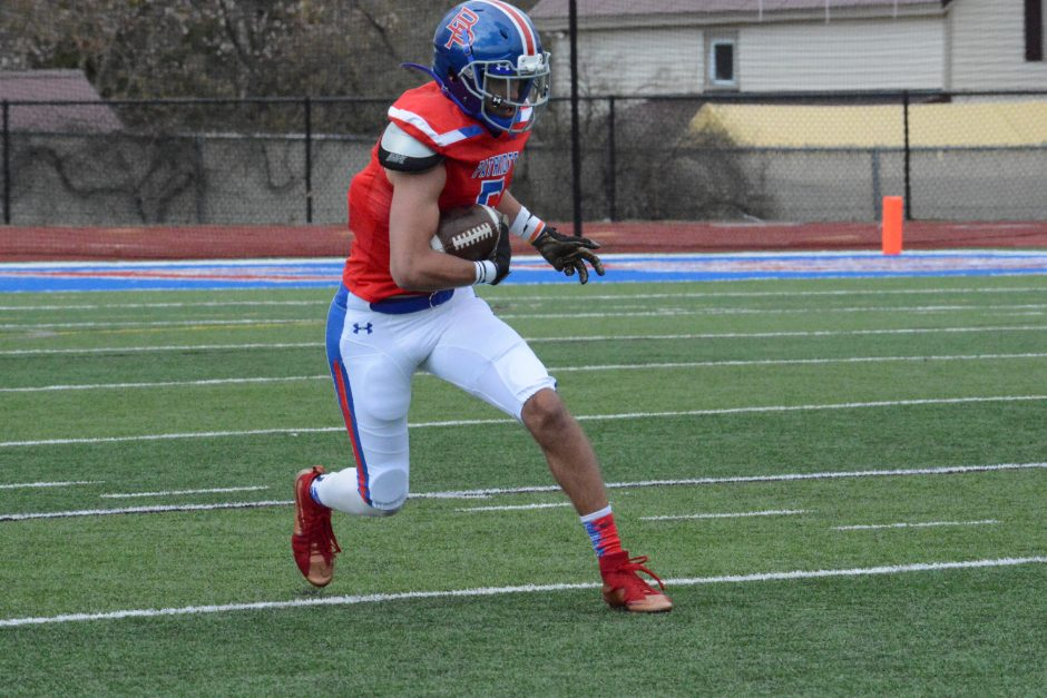 Broadalbin-Perth's Sean Helfrich races into the end zone on a 20-yard touchdown reception against Johnstown during a football game on Saturday, April 17 at Patriot Field in Broadalbin.