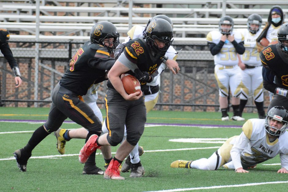 Canajoharie/Fort Plain running back Max Prime (22) runs through a tackle during a football game against Helderberg Valley on Friday, April 2 at Lynch Literacy Academy in Amsterdam.