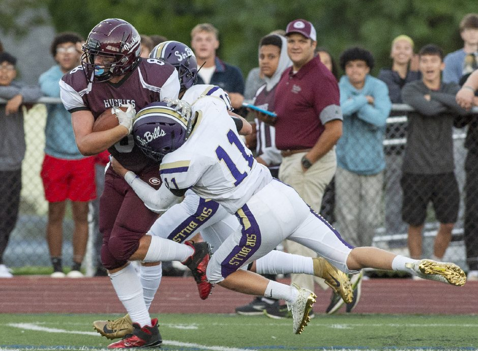 Gloversville's Kyle Robare with the ball against Johnstown's Benjamin Krempa and Andrew Lake during Friday's high school football game at Knox Field.