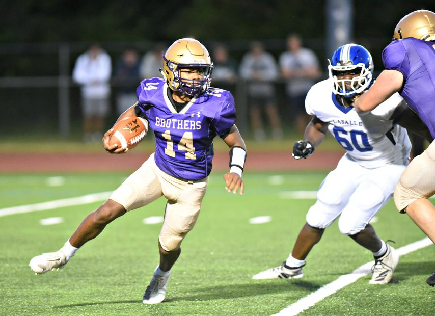 CBA quarterback Donald Jonescarries the ball against La Salle during Friday's Section II football game at Christian Brothers Academy.