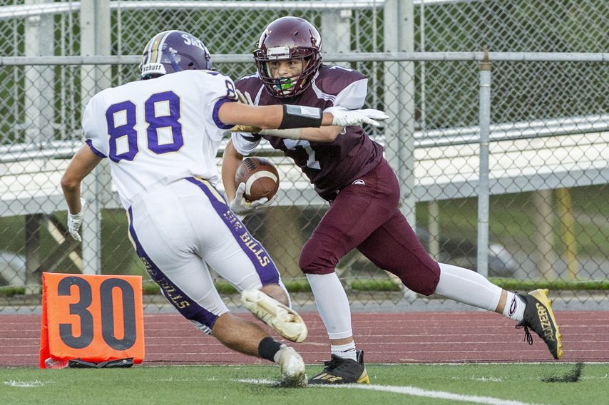 Gloversville's Dominic Dorman runs with the ball against Johnstown's Brandon Frank during their football game at Knox Field in Johnstown on Friday, September 3, 2021.