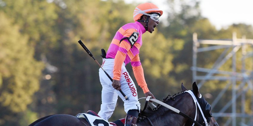 Ricardo Santana Jr. stands in the saddle in celebration after Max Player wins the Jockey Club Gold Cup at Saratoga on Saturday.