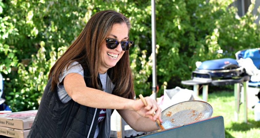 Colette Rabacs from Westport, Connecticut, gives a pot of sausage and peppers a stir as part of her tailgating activities prior to kickoff of the Union College home opener versus SUNY Morrisville at Frank Bailey Field in Schenectady on Saturday. Her son, Kevin Rabacs, is a junior wide receiver for the Dutchmen.