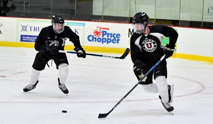 Union College men's hockey head coach Rick Bennett, right, looks on as Taylor Brierley, left, and Fletcher Fineman participate in a drill during a practice on Oct. 15, 2020, at Messa Rink. (Union Athletics photo)