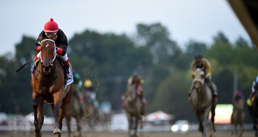 Echo Zulu, left, romps in the Grade I Spinaway at Saratoga on Sunday.