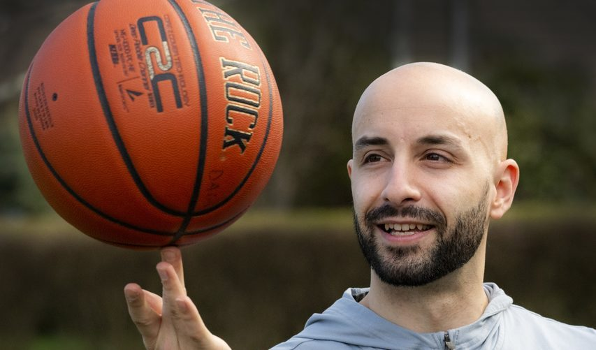 Steve Dagostino spins a basketball on the tip of his finger in April 2020.
