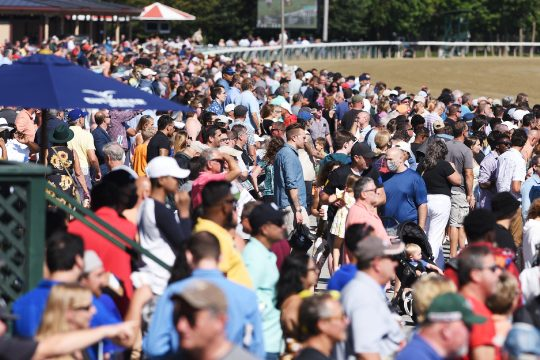 Patrons on the apron after the 5th race at Saratoga Race Course in Saratoga Springs on Monday, September 6, 2021.