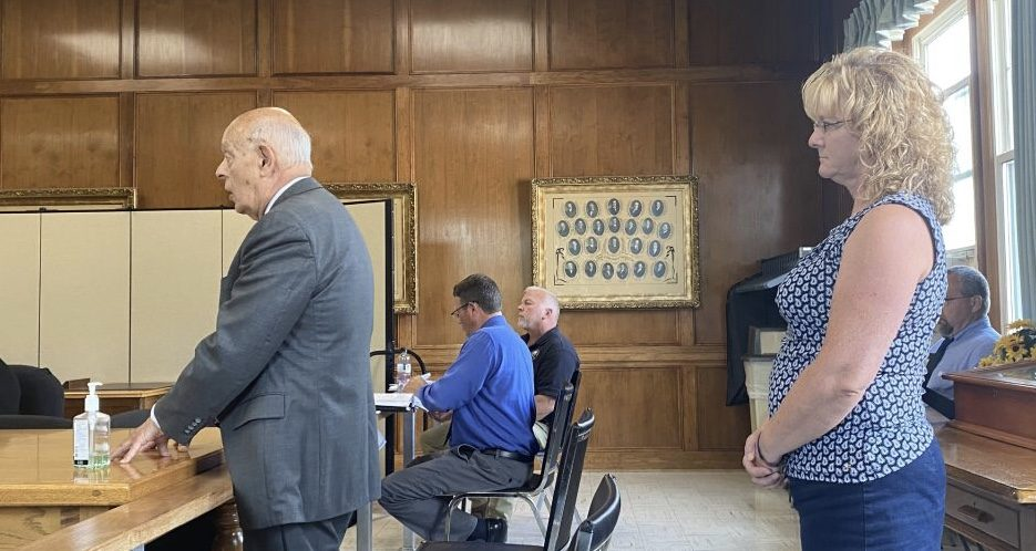At left, Attorney Richard Aulisi speaks to the Fulton County Board of Supervisors Public Works Committee on Aug. 30 on behalf of Chris Rizzo Trucking, whose co-owner, Megan Rizzo, stands at right.