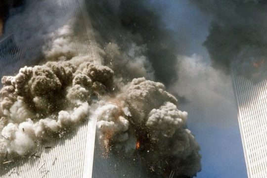 The south tower of the World Trade Center, left, begins to collapse after a terrorist attack Sept. 11, 2001.