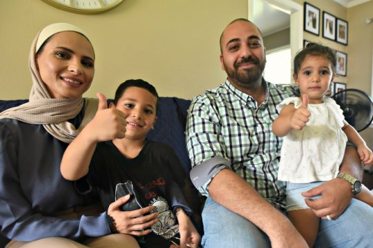 Osama Mustafa with his wife, Aya, and children, Fuad, 5, and Julia, 2, in their home in Gloversville in August.