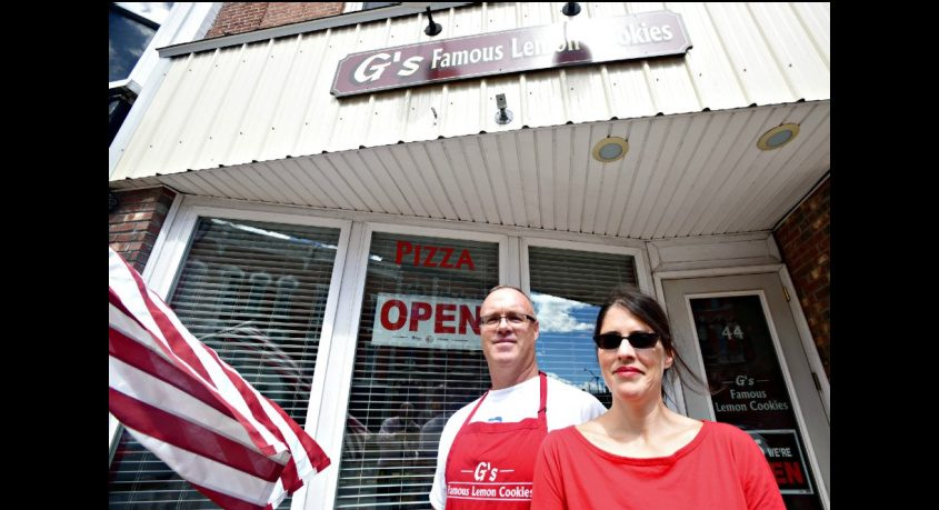 Regina and Mike Flint stand outside G's Famous Lemon Cookies at 44-46 Main St. in Amsterdam on Friday.