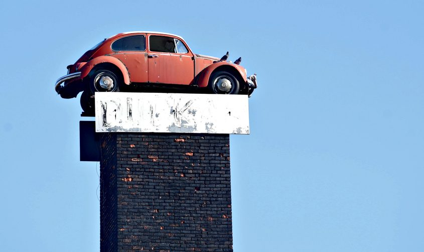 TheVolkswagen Beetle that sits atop a smokestack at the former site of Dudka's Garage on Carmichael Street in Amsterdam is seen on March 21.