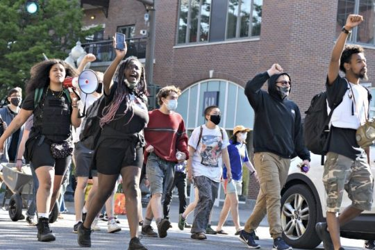 Lexis Figuereo leads Black Lives Matter protestors up Broadway in Saratoga Springs as they made their way to City Hall from Congress Park in May.