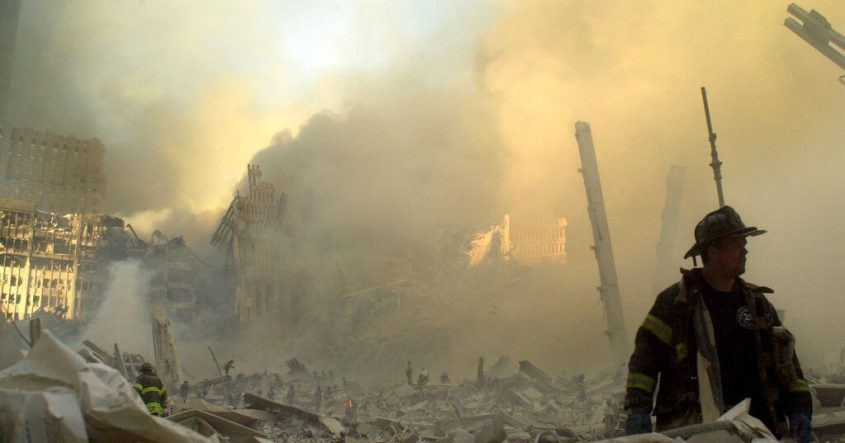 A lone firefighter moves through piles of debris at the site of the World Trade Center in New York, Sept. 11, 2001.