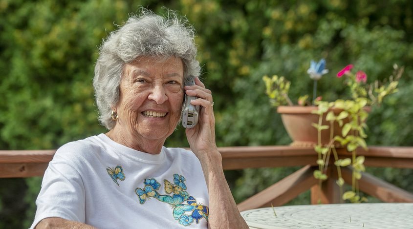 Oliva Sheldon outside her home in Rotterdam with her phone she used to call her late sister on every 9/11.