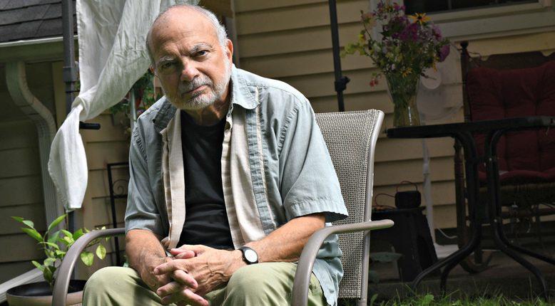Ray Simboli, 70, sits outside his Burnt Hills home.