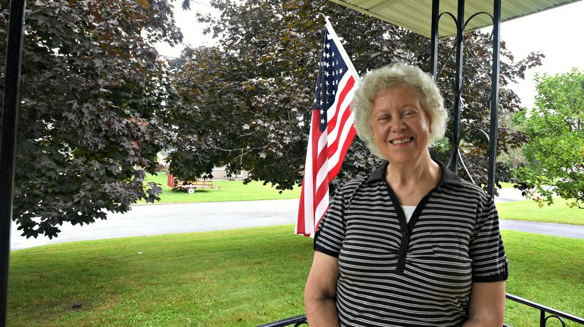 Christine Andrzejewski on her front porch at her house on Julia Street in Amsterdam.