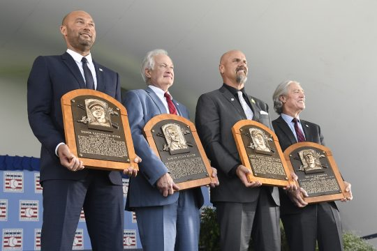 Hall of Fame inductees, from left, Derek Jeter, Donald Fehr (accepting for the late Marvin Miller), Larry Walker and Ted Simmons hold their plaques for photos after the induction ceremony at Clark Sports Center on Wednesday at the National Baseball Hall of Fame in Cooperstown. (Hans Pennink/The Associated Press)