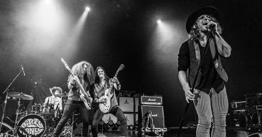 Vocalist Marc LaBelle, right, leads Dirty Honey to SPAC Tuesday night as the special guest opener for The Black Crowes. Also pictured aredrummer Corey Coverstone, bassist Jusin Smolianand guitarist John Notto. (Photo by Mike Savoia)