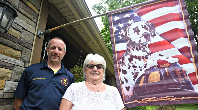 Patricia Bowers of Ballston Spa stands next to her son, Gary Bowers Jr. a firefighter with the Ballston Spa Fire Department.