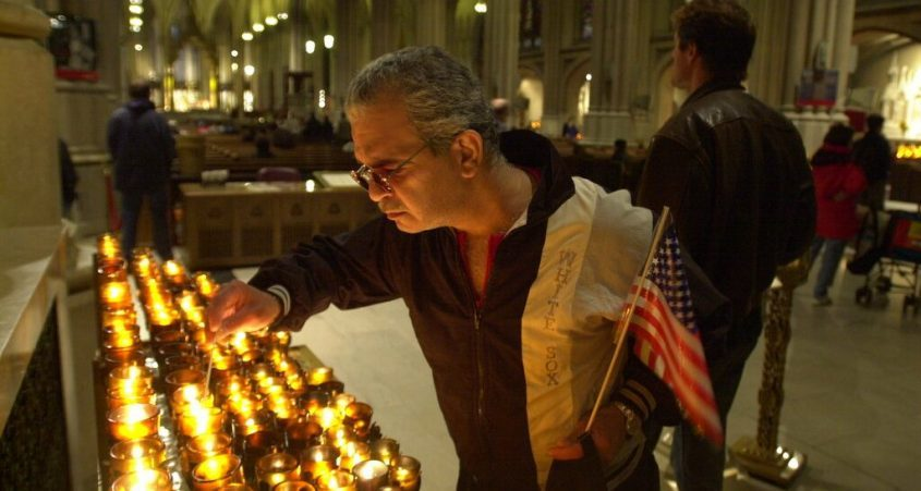 A man lights a candle on Sept. 14, 2001 in memoriam of the victims of the Sept. 11th terrorist attacks