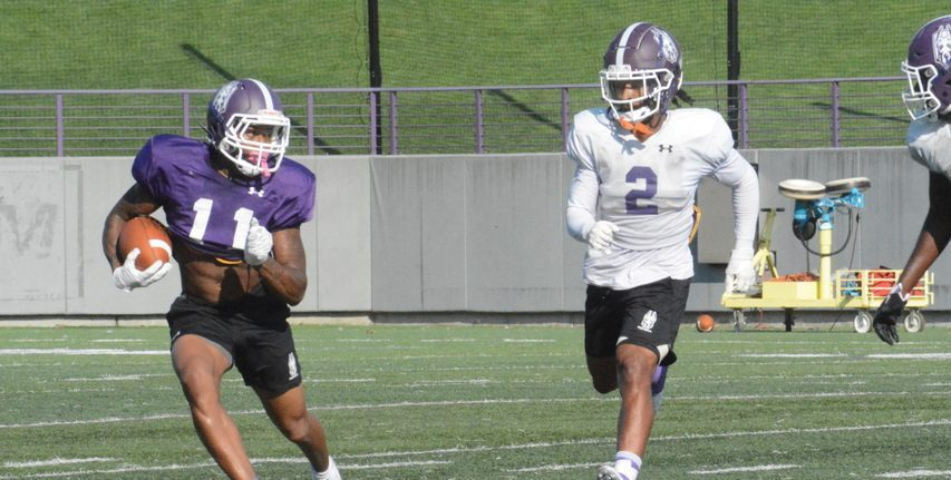 UAlbany wide receiver Roy Alexander (11) gets away from safety Tyler Carswell while running after a catch during football practice on Wednesday, Sept. 8 at Tom & Mary Casey Stadium in Albany.